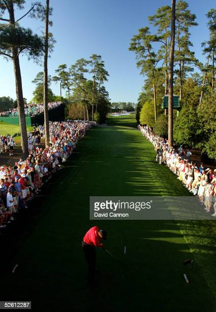 Tiger Woods hits his tee shot on the 18th tee during the final round of The Masters at the Augusta National Golf Club on April 10 2005 in Augusta...