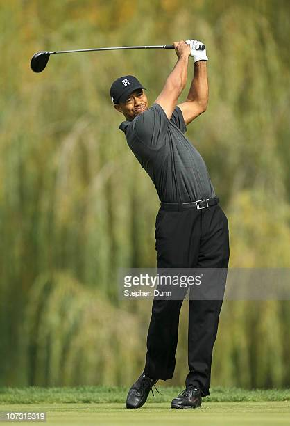 Tiger Woods hits his tee shot on the fifth hole during round two of the Chevron World Challenge at Sherwood Country Club on December 3, 2010 in...