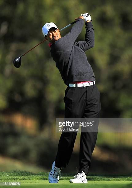 Tiger Woods hits his tee shot on the fifth hole during the first round of the Chevron World Challenge at Sherwood Country Club on December 1 2011 in...