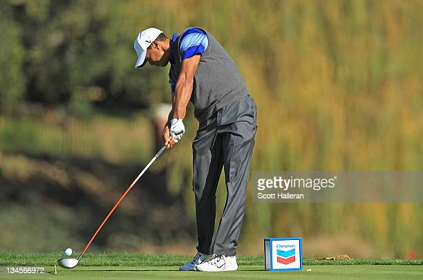 Tiger Woods hits his tee shot on the fifth hole during the second round of the Chevron World Challenge at Sherwood Country Club on December 2, 2011...