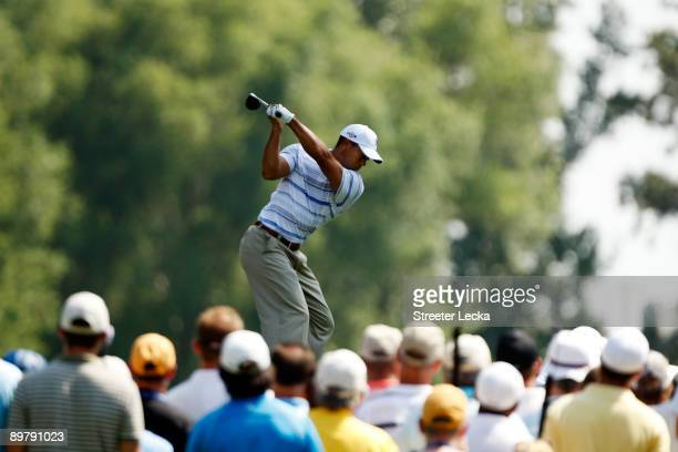 Tiger Woods hits his tee shot on the fifth hole during the second round of the 91st PGA Championship at Hazeltine National Golf Club on August 14,...