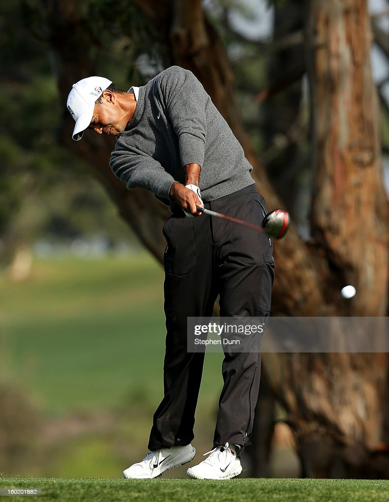 Tiger Woods hits his tee shot on the fifth hole during the third round of the Farmers Insurance Open on the South Course at Torrey Pines Golf Course on January 27, 2013 in La Jolla, California.