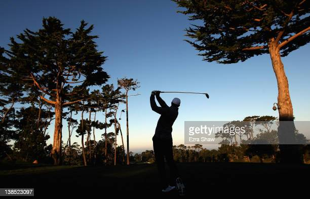 Tiger Woods hits his tee shot on the first hole during a practice round for the ATT Pebble Beach National ProAm at the Monterey Peninsula Country...