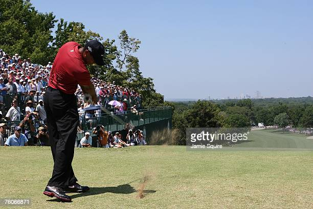 Tiger Woods hits his tee shot on the first hole during the final round of the 89th PGA Championship at the Southern Hills Country Club on August 12...