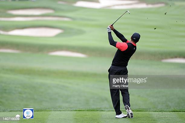 Tiger Woods hits his tee shot on the fourth hole during the final round of the ATT Pebble Beach National ProAm at Pebble Beach Golf Links on February...