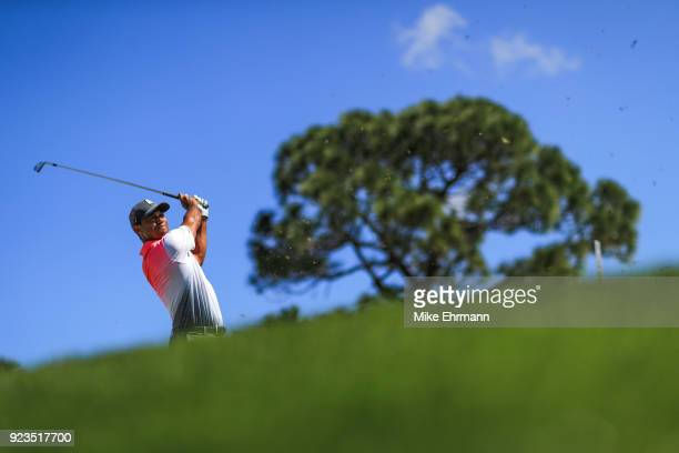 Tiger Woods hits his tee shot on the fourth hole during the second round of the Honda Classic at PGA National Resort and Spa on February 23 2018 in...