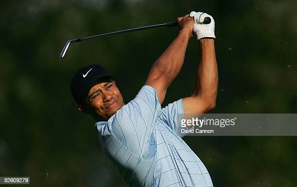 Tiger Woods hits his tee shot on the fourth hole during the third round of The Masters at the Augusta National Golf Club on April 9 2005 in Augusta...