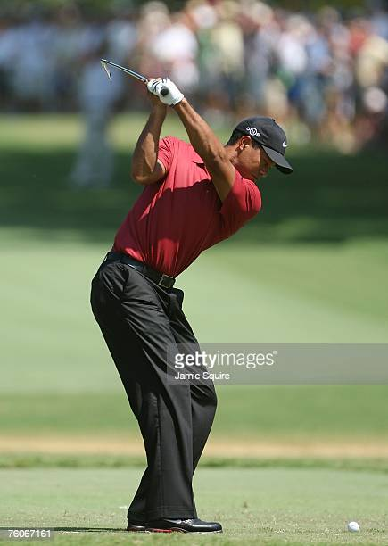 Tiger Woods hits his tee shot on the seventh hole during the final round of the 89th PGA Championship at the Southern Hills Country Club on August 12...