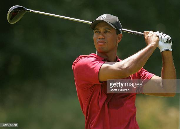 Tiger Woods hits his tee shot on the sixth hole during the third round of the ATT National at Congressional Country Club on July 8 2007 in Bethesda...