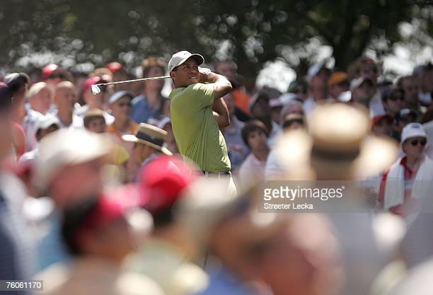 Tiger Woods hits his tee shot on the sixth hole during the third round of the 89th PGA Championship at the Southern Hills Country Club on August 11...