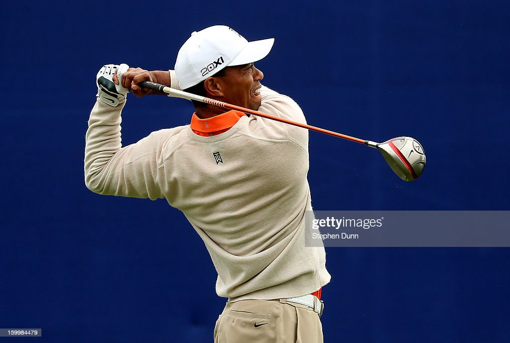 Tiger Woods hits is tee shot on the seventh hole during the first round of the Farmers Insurance Open on the South Course at Torrey Pines Golf Course on January 24, 2013 in La Jolla, California.