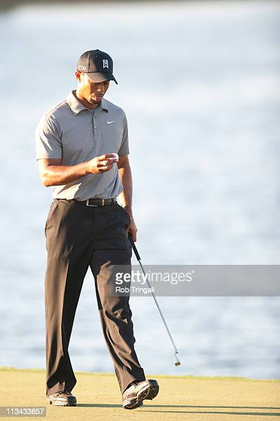 Tiger Woods hits looks on from the 18th hole during the second round at the WGCCadillac Championship at the TPC Blue Monster at the Doral Golf Resort...