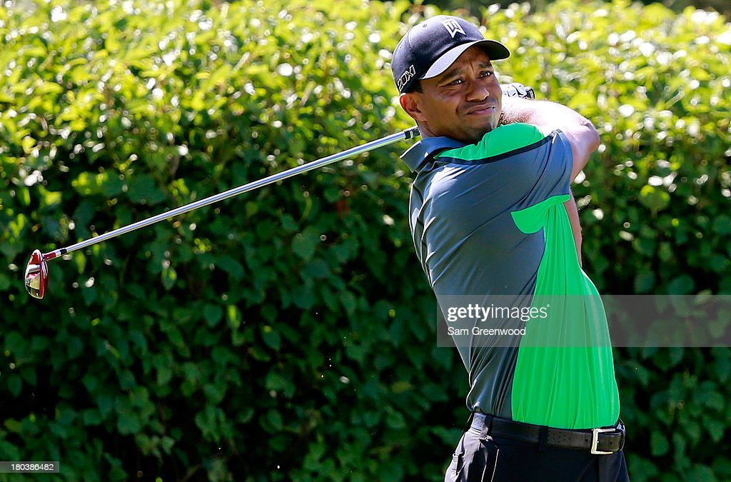 Tiger Woods hits off the 13th tee during the First Round of the BMW Championship at Conway Farms Golf Club on September 12, 2013 in Lake Forest, Illinois.