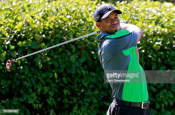 Tiger Woods hits off the 13th tee during the First Round of the BMW Championship at Conway Farms Golf Club on September 12, 2013 in Lake Forest,...