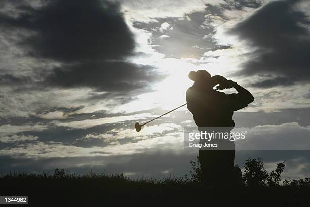 Tiger Woods hits off the seventh tee during practice on August 14, 2002 for the PGA Championship at Hazeltine National Golf Club in Chaska, Minnesota.