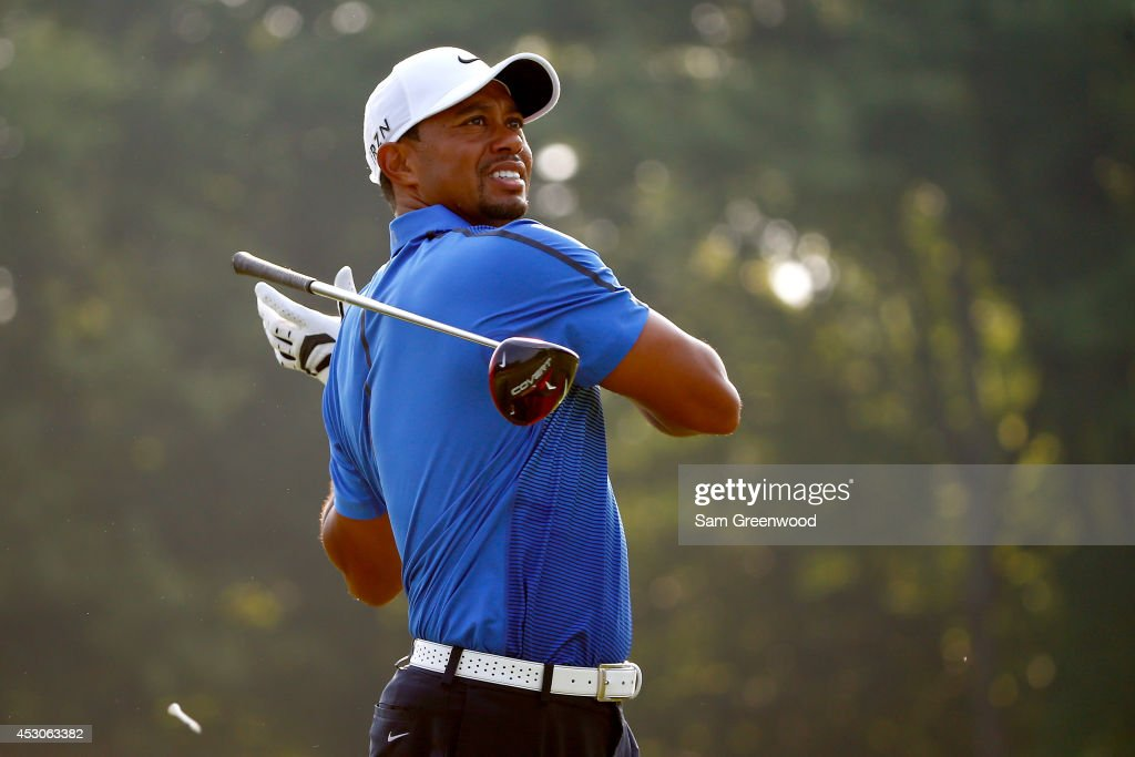 Tiger Woods hits off the sixth tee during the third round of the World Golf Championships-Bridgestone Invitational at Firestone Country Club South Course on August 2, 2014 in Akron, Ohio.