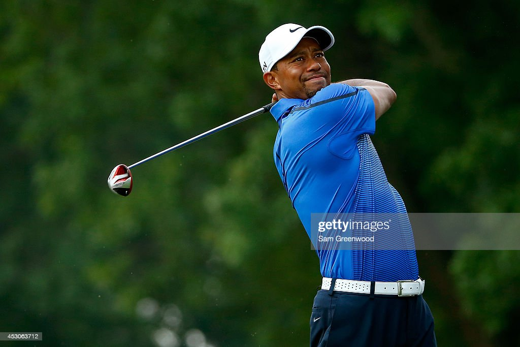 Tiger Woods hits off the third tee during the third round of the World Golf Championships-Bridgestone Invitational at Firestone Country Club South Course on August 2, 2014 in Akron, Ohio.