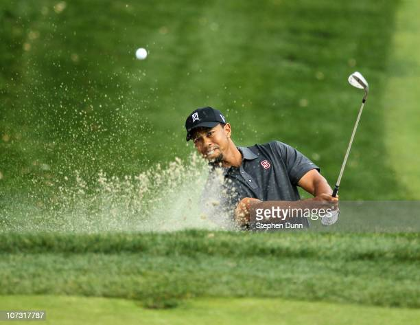 Tiger Woods hits out of a bunker on the 11th hole during round two of the Chevron World Challenge at Sherwood Country Club on December 3, 2010 in...