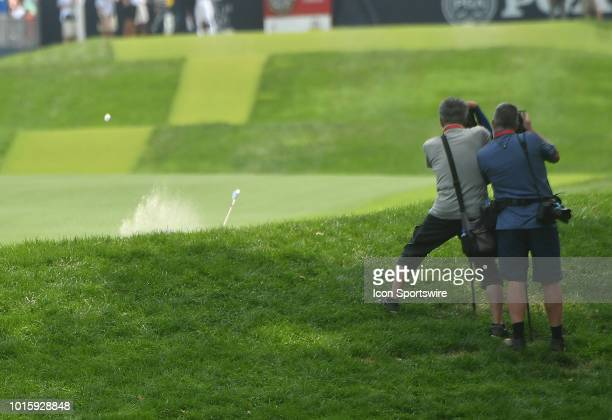 Tiger Woods hits out of a bunker on the hole during the final round of the PGA Championship on August 12 at Bellerive Country Club St Louis MO