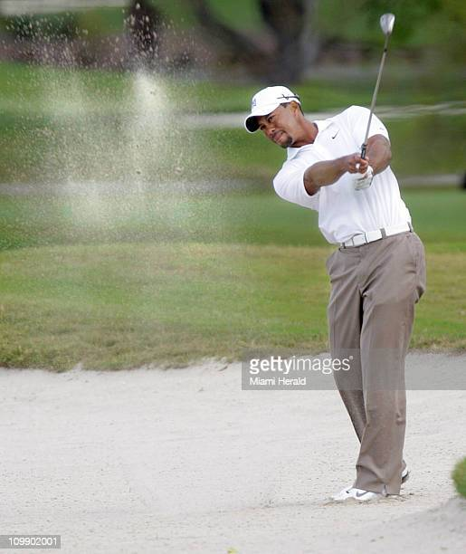 Tiger Woods hits out of a sand trap during a practice round for the World Golf ChampionshipCadillac Championship at Doral Golf Resort Spa in Doral...