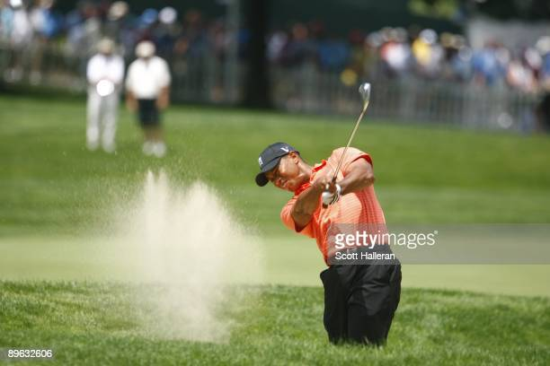 Tiger Woods hits out of bunker during the first round of the ATT National hosted by Tiger Woods at Congressional Country Club on July 2 2009 in...