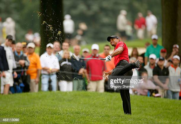 Tiger Woods hits out of the rough on the second hole during the final round of the World Golf Championships-Bridgestone Invitational at Firestone...