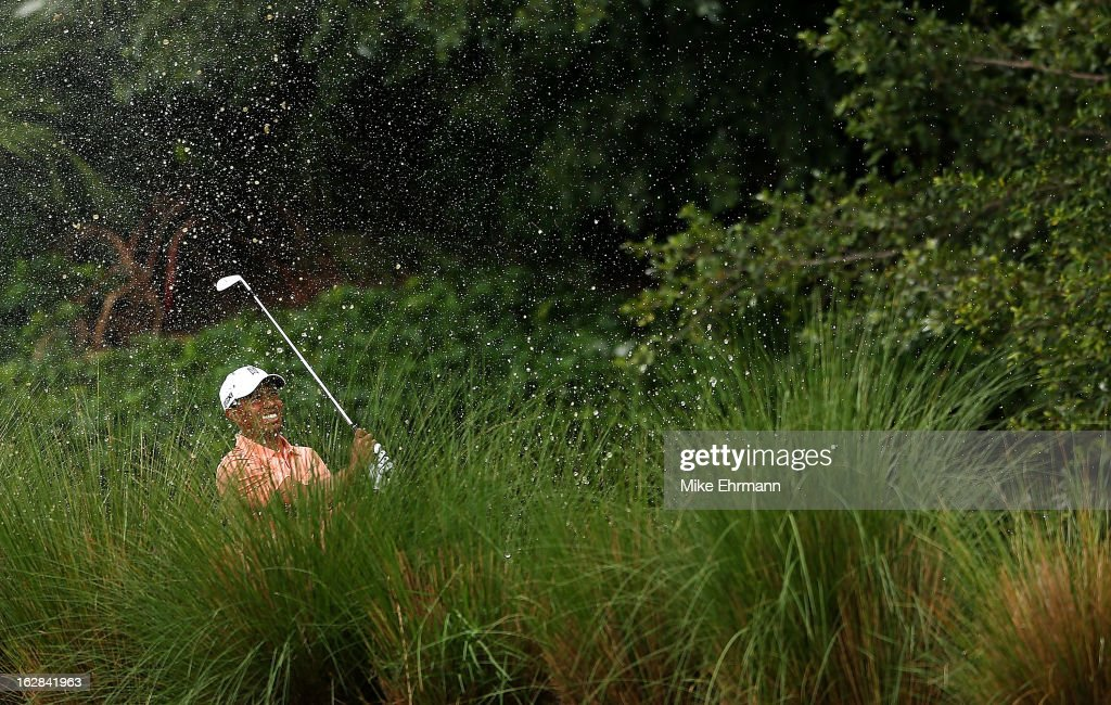 Tiger Woods hits out of the water on the seventh hole during the first round of the Honda Classic at PGA National Resort and Spa on February 28, 2013 in Palm Beach Gardens, Florida.
