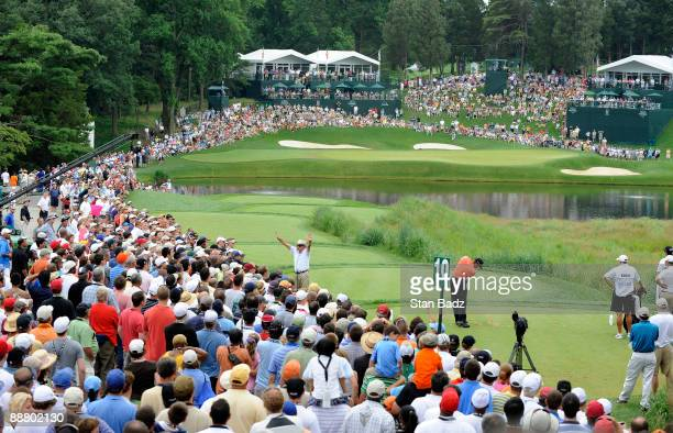 Tiger Woods hits to the 10th green during the first round of the ATT National at Congressional Country Club on July 2 2009 in Bethesda Maryland