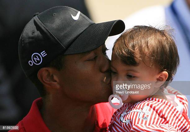 Tiger Woods holds his daughter Sam after winning the playoff round of the 108th US Open at the Torrey Pines Golf Course on June 16 2008 in San Diego...