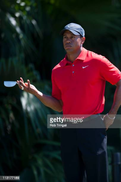 Tiger Woods holds his putter in his hand during the final round at the WGCCadillac Championship at the TPC Blue Monster at the Doral Golf Resort and...