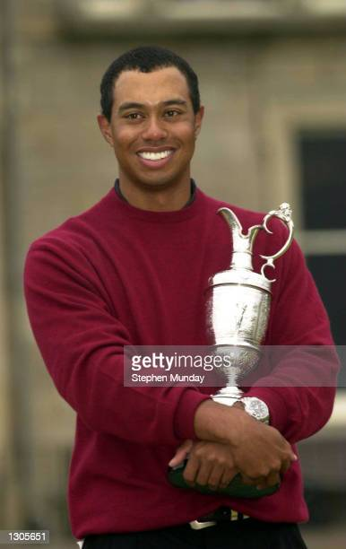 Tiger Woods holds the claret jug after his victory in the British Open Championships at the Old Course St Andrews Scotland July 23 2000