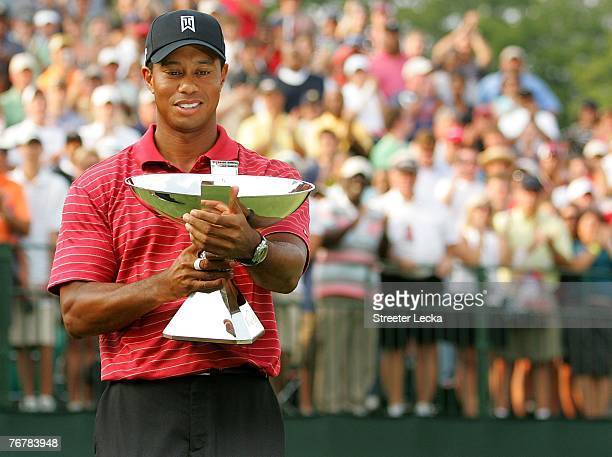 Tiger Woods holds the FedEx Cup trophy after winning the TOUR Championship, the final event of the new PGA TOUR Playoffs for the FedExCup at East...