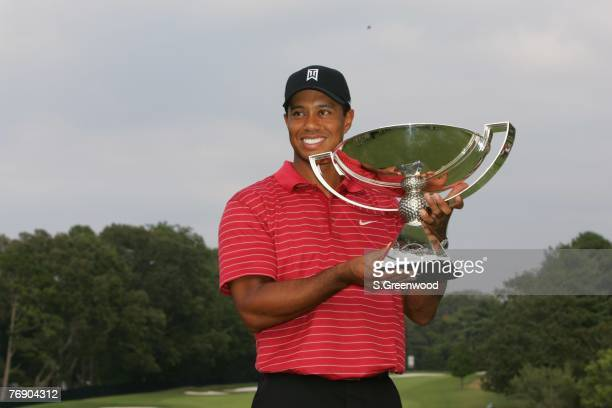 Tiger Woods holds the FedEx Cup trophy following the final round of the TOUR Championship the final event of the new PGA TOUR Playoffs for the...
