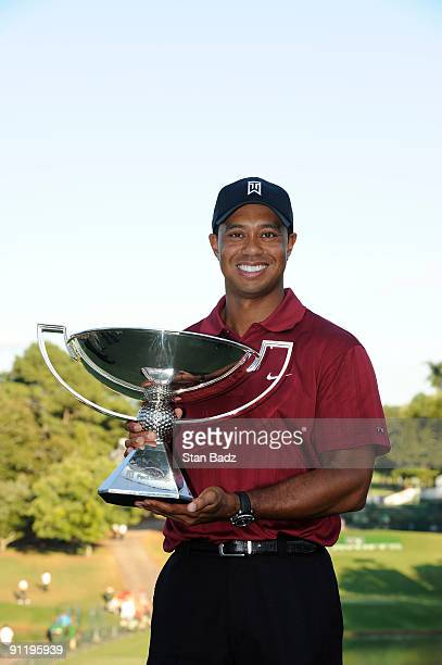 Tiger Woods holds the FedExCup Trophy after the final round of THE TOUR Championship presented by Coca-Cola, the final event of the PGA TOUR Playoffs...