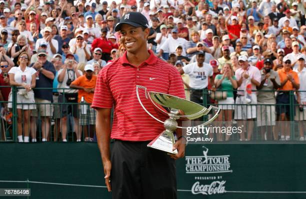 Tiger Woods holds the FedExCup trophy following the fourth round of THE TOUR Championship, the final event of the new PGA TOUR Playoffs for the...