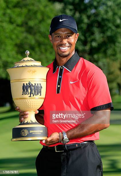 Tiger Woods holds the Gary Player Cup trophy after the Final Round of the World Golf Championships-Bridgestone Invitational at Firestone Country Club...