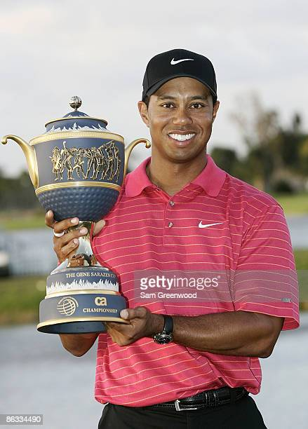 Tiger Woods holds the Gene Sarazen trophy after winning the WGCCA Championship held on the Blue Course at Doral Golf Resort and Spa in Doral Florida...
