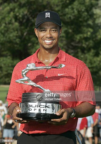 Tiger Woods holds the trophy after winning his 50th PGA TOUR event after the fourth and final round of the Buick Open at Warwick Hills Golf and...