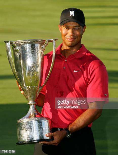 Tiger Woods holds the trophy after winning the BMW Championship, the third event of the new PGA TOUR Playoffs for the FedExCup at Cog Hill Golf and...