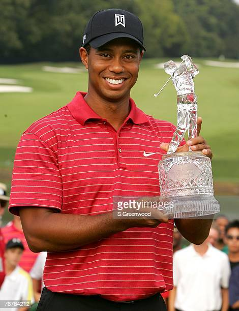 Tiger Woods holds the trophy after winning the TOUR Championship the final event of the new PGA TOUR Playoffs for the FedExCup at East Lake Golf Club...