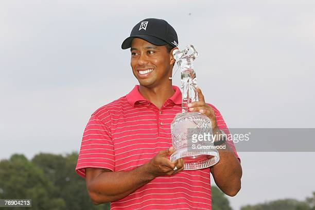 Tiger Woods holds the trophy after winning the TOUR Championship, the final event of the new PGA TOUR Playoffs for the FedExCup at East Lake Golf...