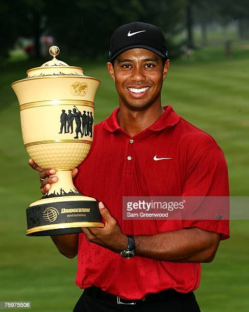 Tiger Woods holds the trophy after winning the WGC-Bridgestone Invitational at Firestone Country Club August 5, 2007 in Akron, Ohio.