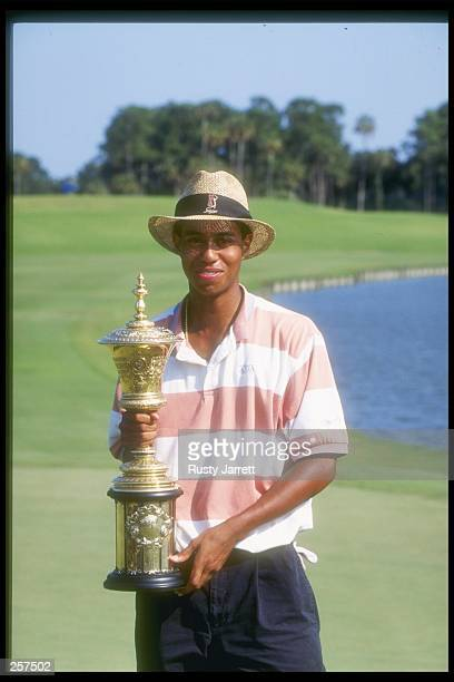 Tiger Woods holds the trophy of victory after completing the U.S. Amateur Championship tournament at the TPC at Sawgrass in Ponte Vedra Beach,...