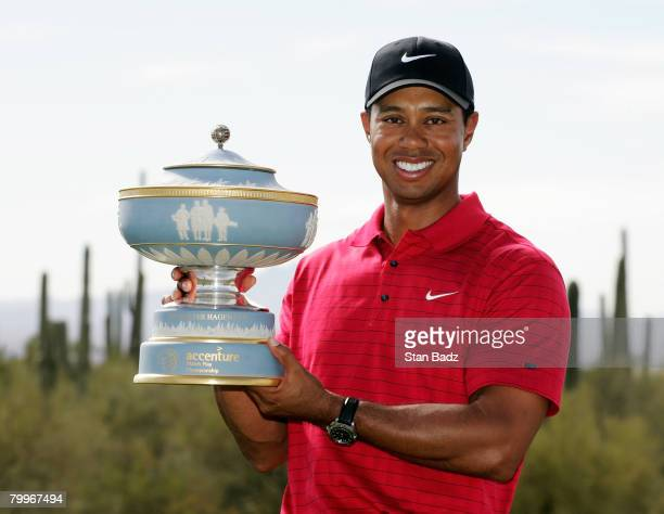 Tiger Woods holds the Walter Hagen Cup after winning the Championship match of the WGCAccenture Match Play Championship at The Gallery at Dove...