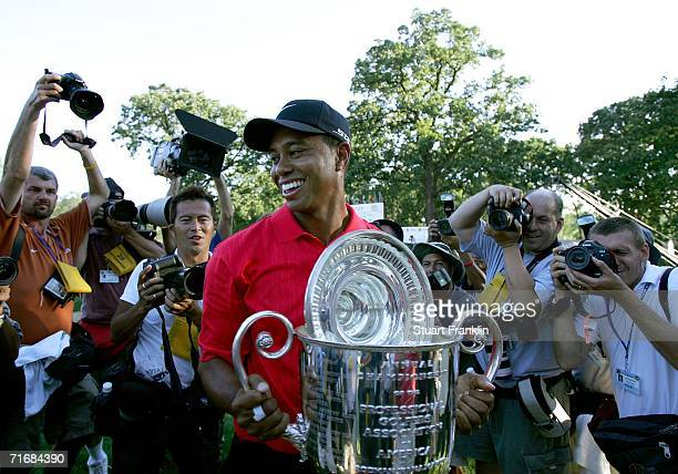 Tiger Woods holds the Wanamaker Trophy after winning the 2006 PGA Championship at Medinah Country Club on August 20 2006 in Medinah Illinois