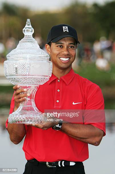 Tiger Woods holds the winner's trophy after winning the Ford Championship at Doral on March 6 2005 at the Doral Golf Resort and Spa in Miami Florida