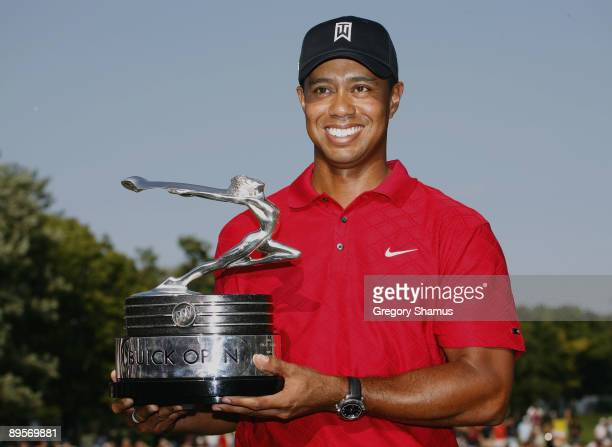 Tiger Woods holds up the trophy after winning the 2009 Buick Open at Warwick Hills Golf and Country Club on August 2 2009 in Grand Blanc Michigan