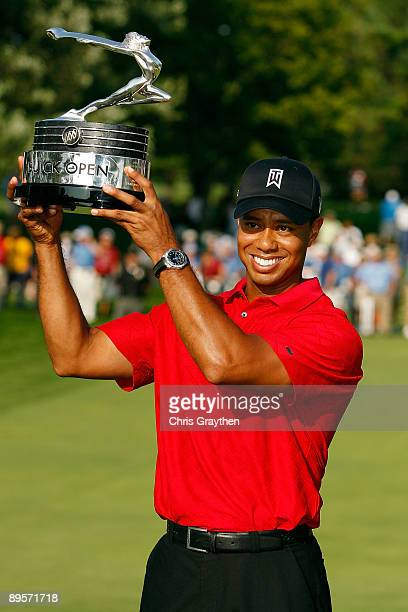Tiger Woods holds up the trophy after winning the final round of the Buick Open at Warwick Hills Golf and Country Club on August 2 2009 in Grand...