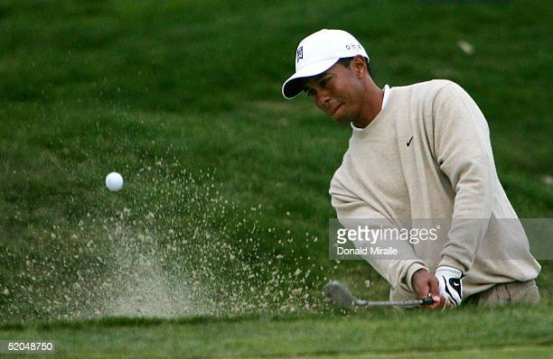 Tiger Woods holes out of the bunker to birdie the 11th hole during the 3rd Round for the Buick Invitational on January 22, 2005 at Torrey Pines Golf...