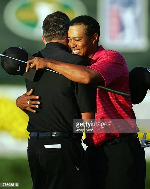 Tiger Woods hugs his caddie after winning the World Golf Championship CA Championship at the Doral Golf Resort and Spa on March 25 2006 in Miami...